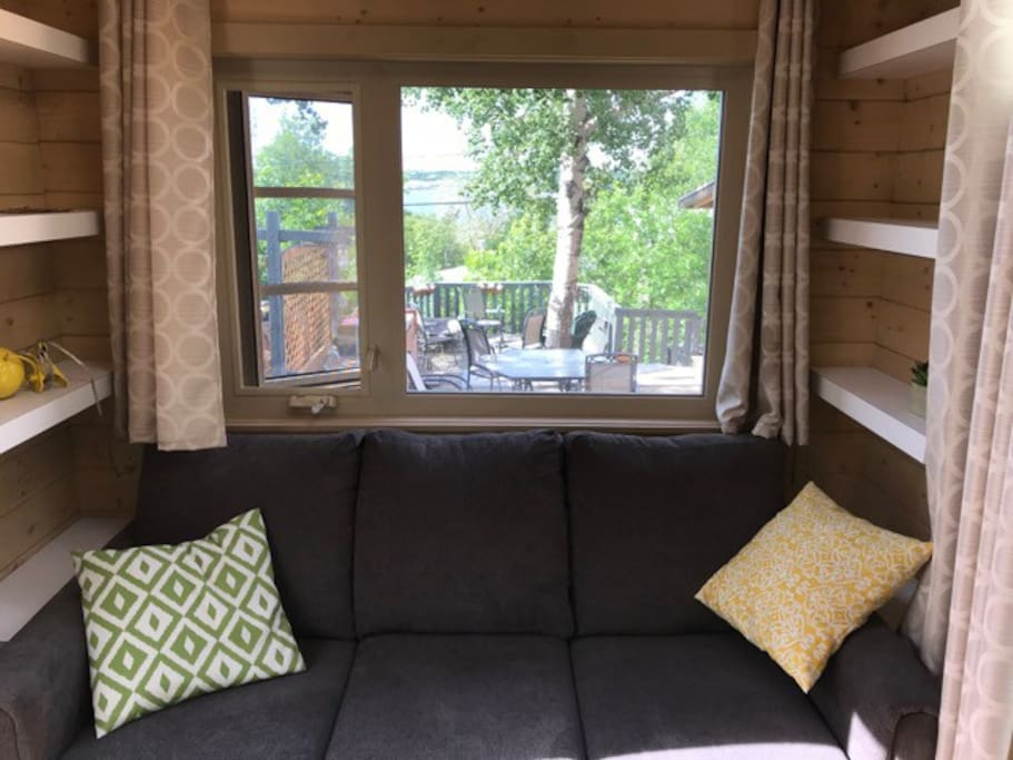 View from inside Tiny House picture window. The pull out double size couch is very comfortable and will sleep 2 adults.