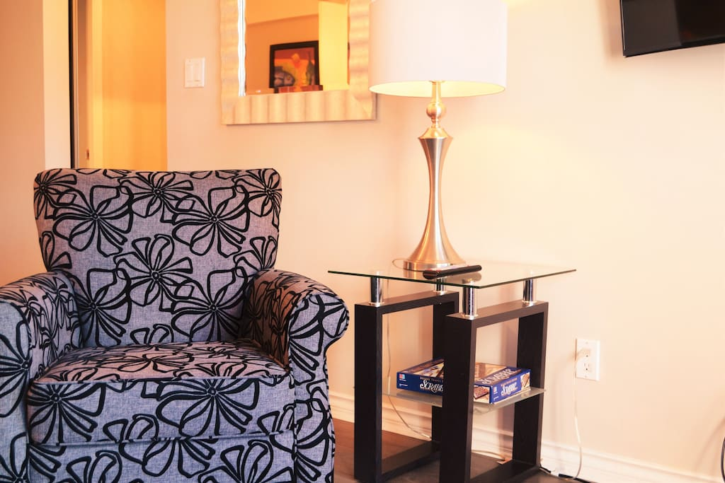 The living room is a comfortable place to watch tv, catch up on work or play a game of Scrabble.