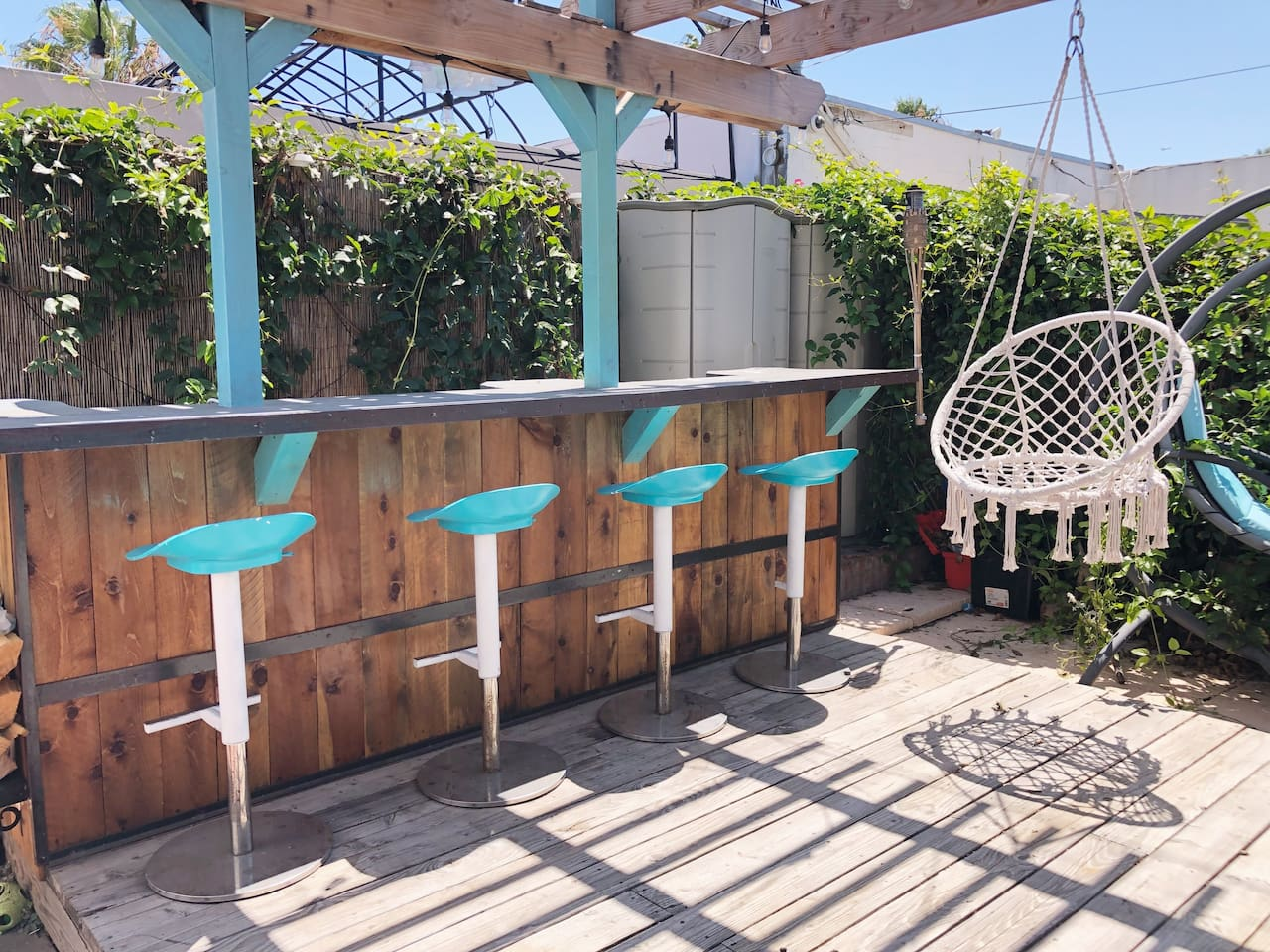 Huge backyard with bar, plenty of seating, BBQ, and fire pit!