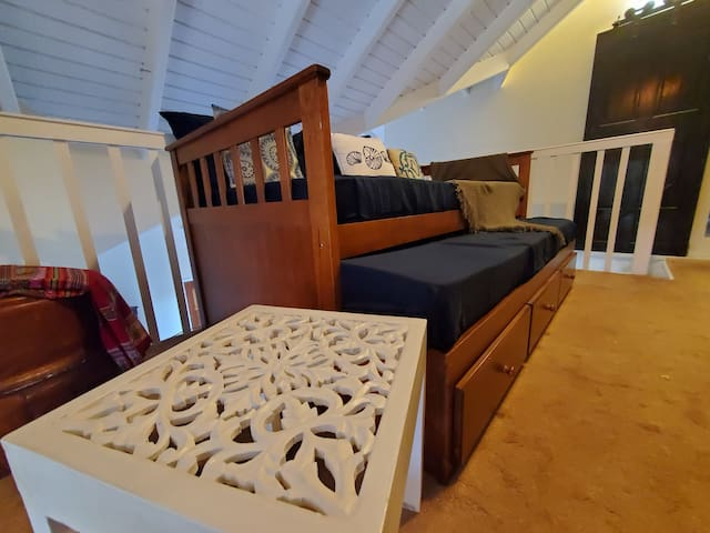Upstairs a trundle bed is perfect for families with kids and works as a day bed for those who need to use the office while away!
