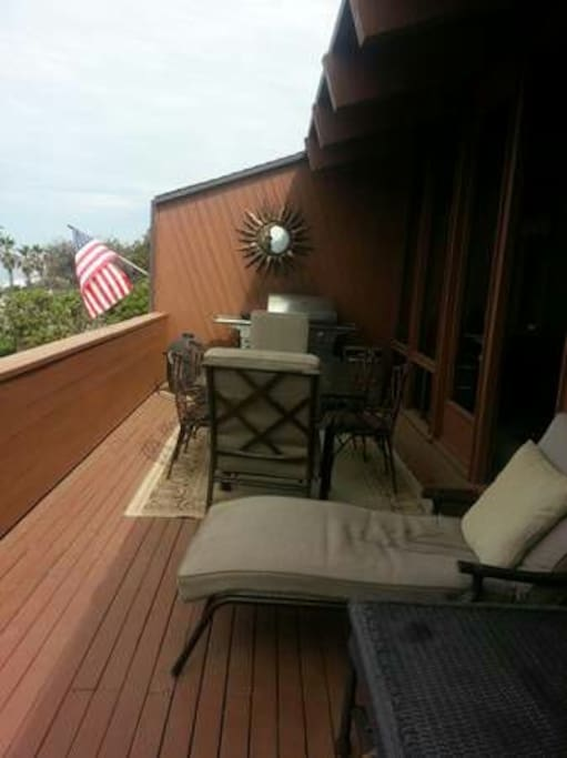 Large Private furnished deck with stainless bbq, lounge chairs,umbrella,table and chairs.