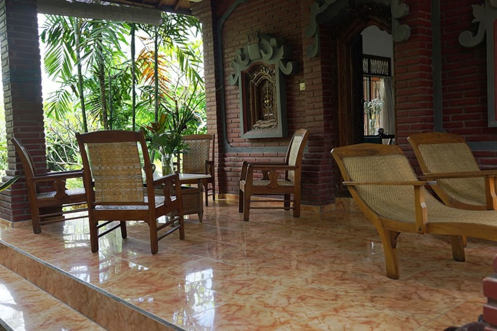 Downstairs terrace with pond and garden view