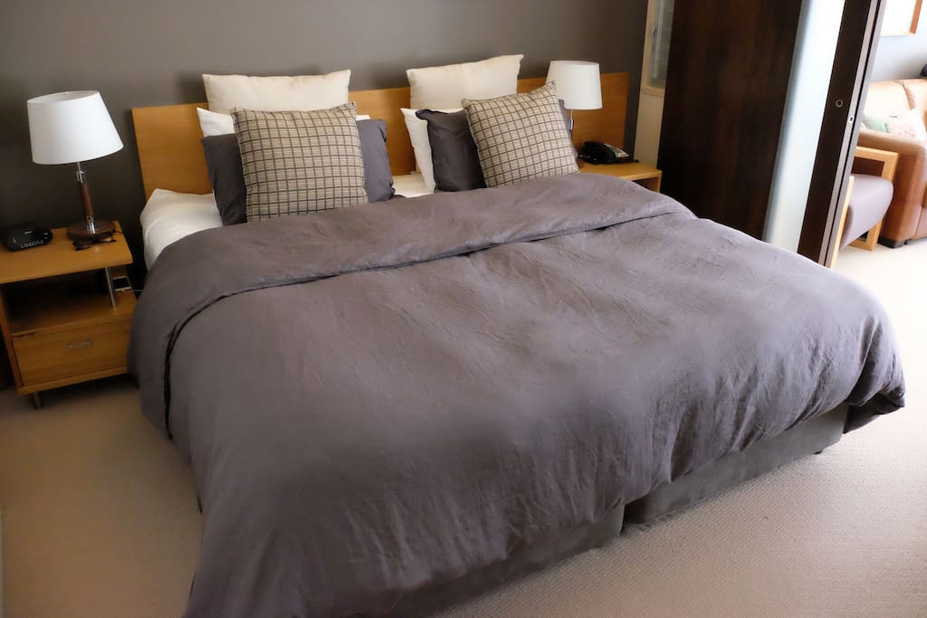 The bedroom with king size bed and luxury linen.