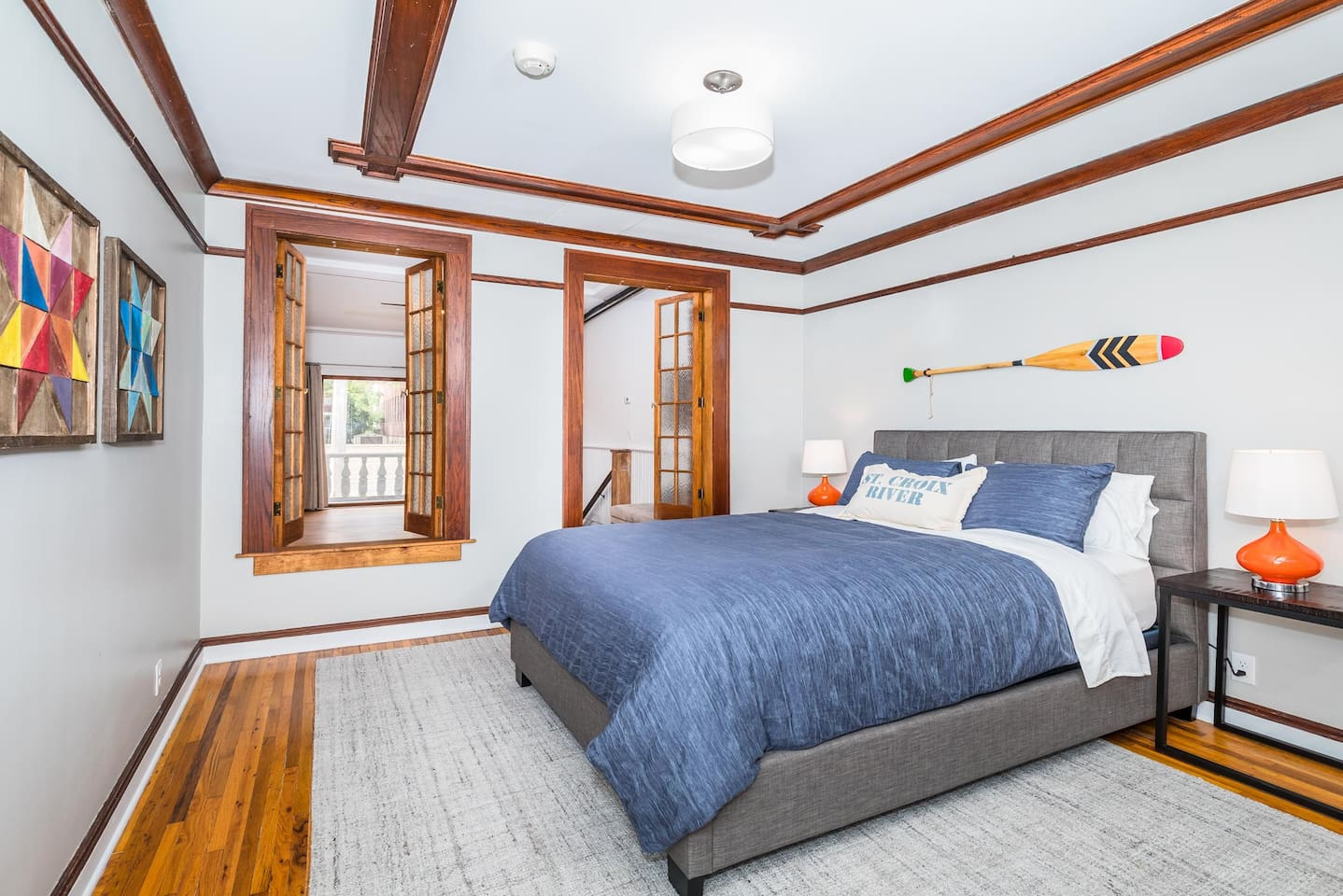 Comfortable queen bed with a view of the living room