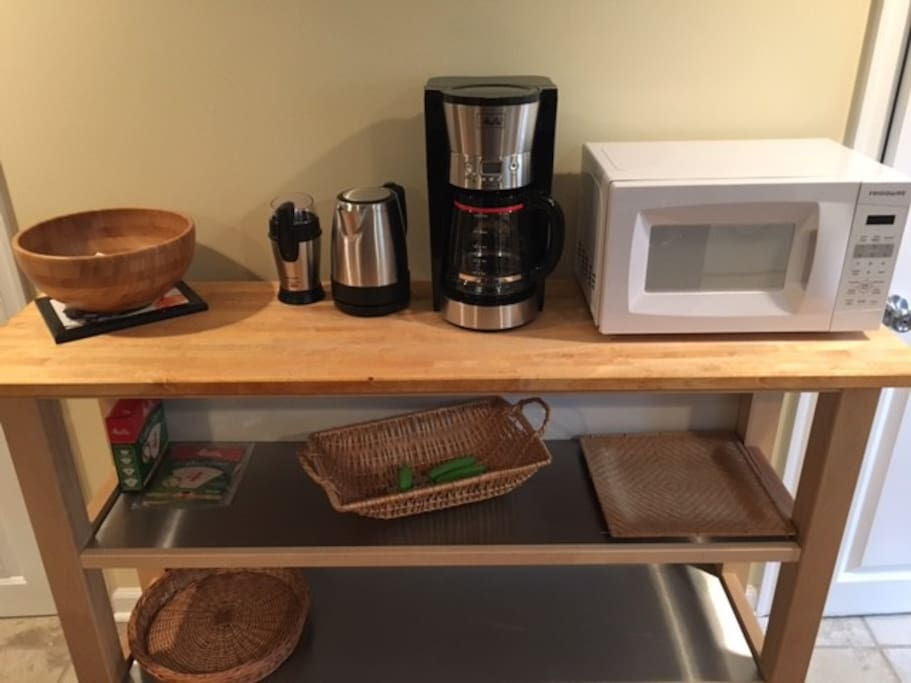 Prep-counter with coffee-maker, coffee grinder, micro-wave & electric kettle.