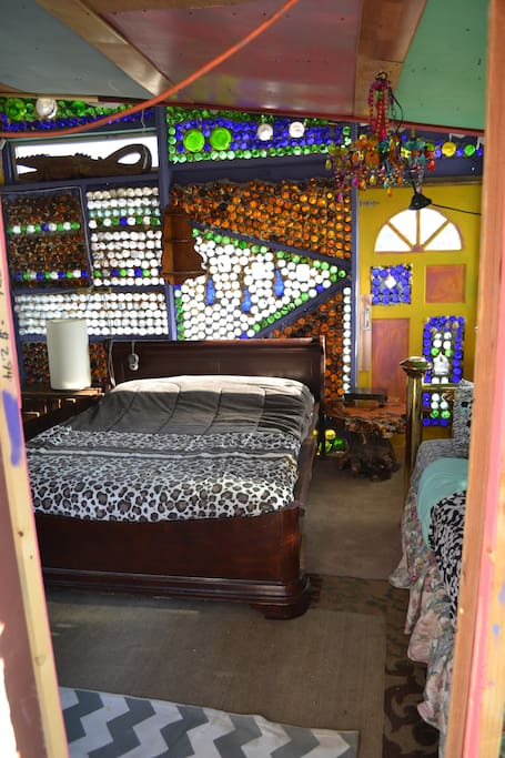 A view of the queen bed and one of the most spectacular walls that mimics African beading patterns.