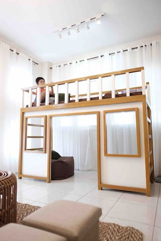 Kid friendly space! A double decker bed/playhouse, watch the kiddos play as you lounge in the living area.