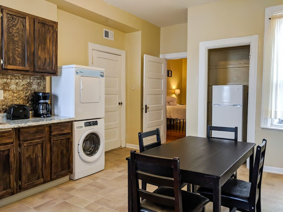One kitchen view showing washer, dryer and refrigerator.