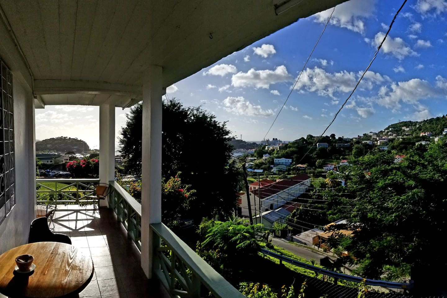 Veranda and view looking out from apt door.