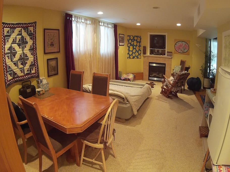Largest area with queen bed, fireplace area and eating area
