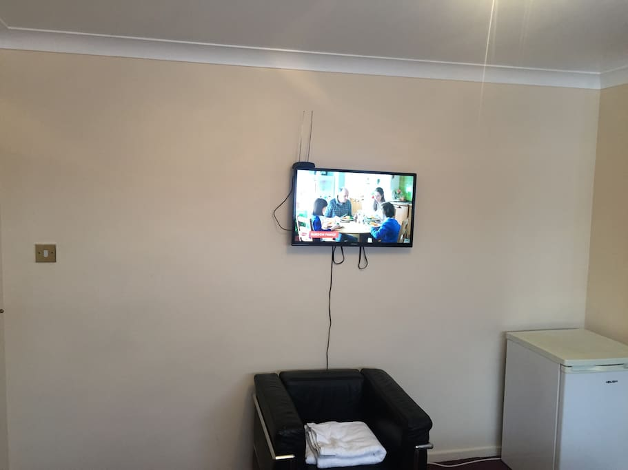 Smart tv with YouTube/Netflix & many more channels .  Also personal Fridge in your room with bottle of water . Guest seat and towel
