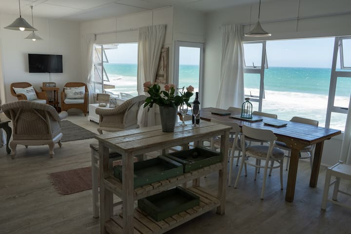 Open plan living/dining room and kitchen - all with beautiful sea views