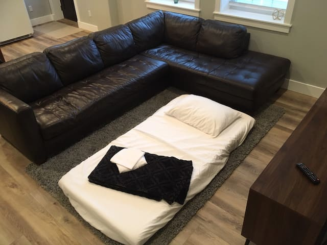 Additional Sleeping includes;  Twin size Floor Mattress  and sleeping on the oversized L shaped Couch
