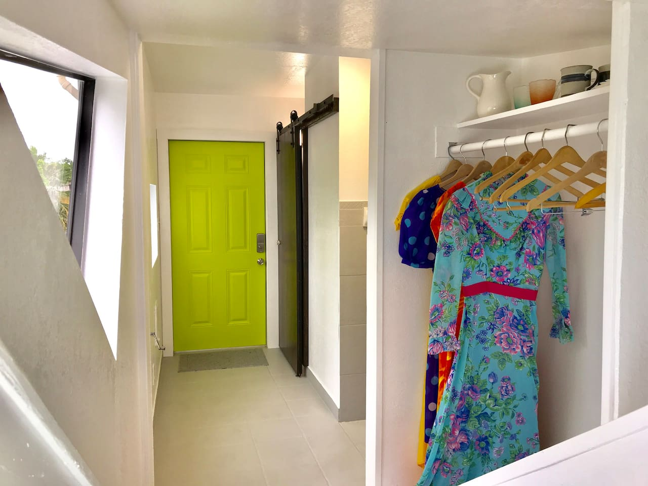 Open studio loft entryway, complete with wooden hangers for your Instagram worthy pics. Vintage coffee mugs, drink pitcher and glasses. Have fun shopping with In-house Wardrobe Stylists at San Antonio's premier vintage clothing store Montage.