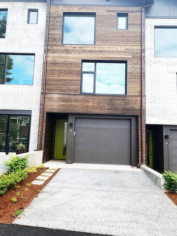 This is the front of Madrona East Loft 3. You may park inside the garage, or out on the driveway.