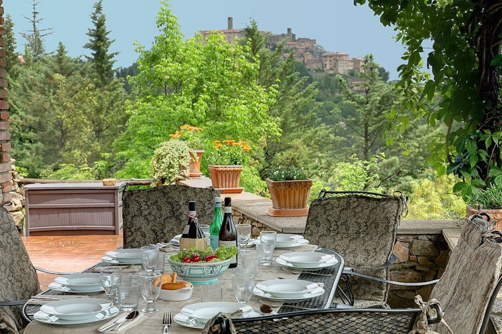 Lunch on the terrace with view of village behind it