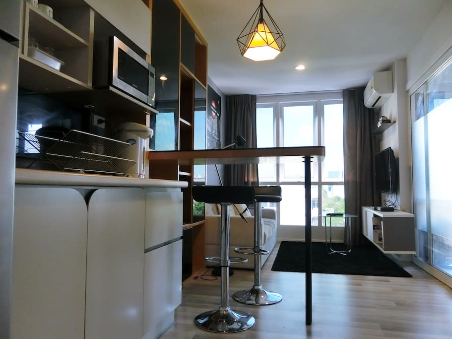 mini bar and 2 stools and microwave oven