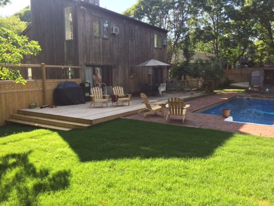 Expanded deck and grass area for playing games