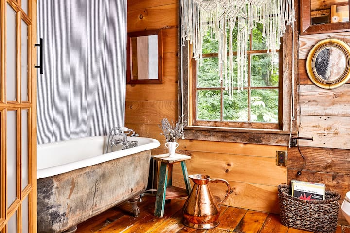 Second Floor // Full bathroom with claw foot tub. High quality, natural toiletries and towels are provided.