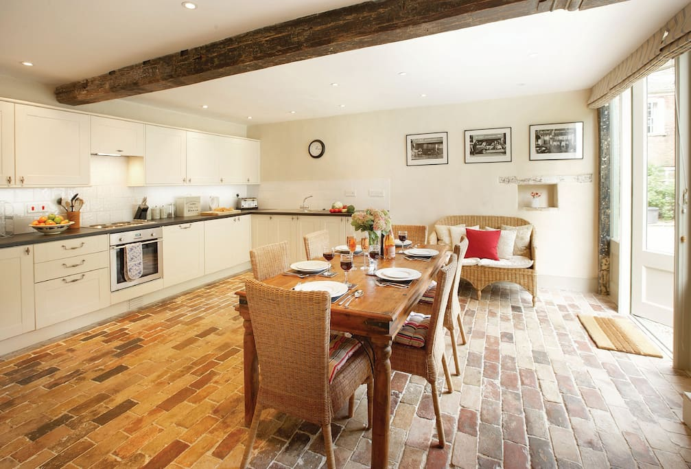 Ground floor: Large, well equipped kitchen with French doors and spacious dining area