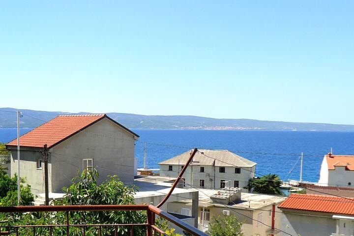 Chambre avec le balcon et la vue sur le mer Sumpetar (Omis) (S-2099-b)
