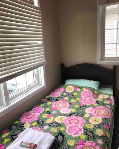 Single bed in cozy bedroom located in Scarborough