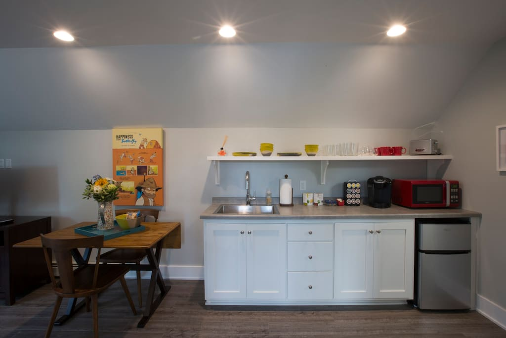 The kitchenette, with all of the basics, including Keurig (K-Cups supplied), Microwave, Toaster and mini-fridge/freezer.  Deep stainless steel sink for cleanup.  We always make sure to keep snacks on hand.