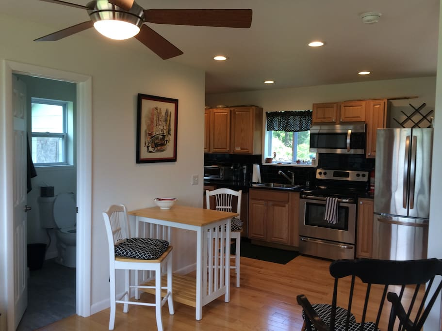 Full sized table and chairs for family dining at opposite end of room with large window looking out on to meadow and views of the Hudson. First floor bathroom with shower.