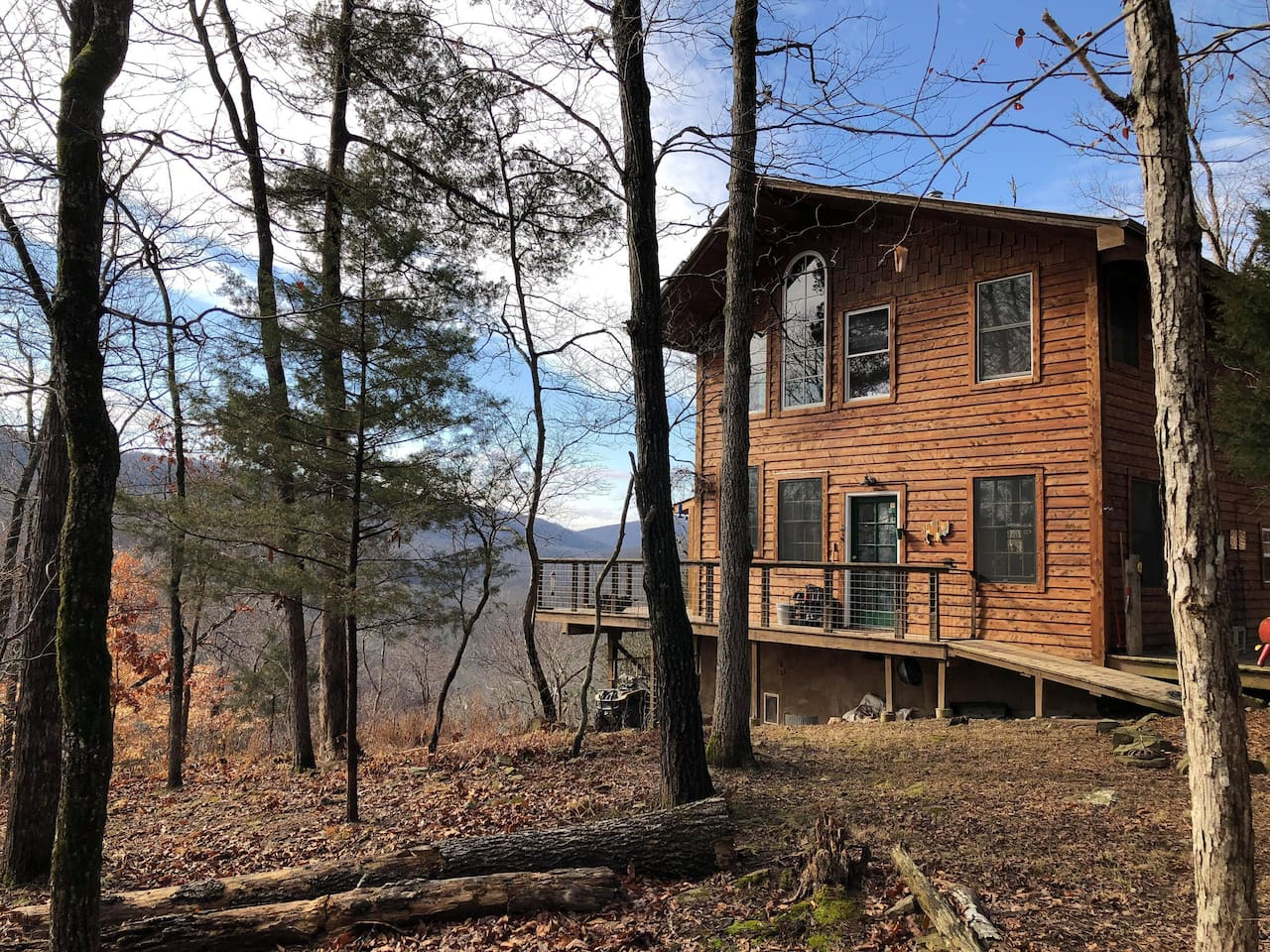 Off-grid cabin with modern solar system faces due south over Beech Creek, which feeds into the Buffalo River one mile downstream.