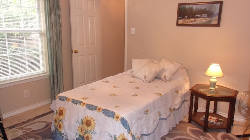 Twin bed/desk; near everything; quiet neighborhood