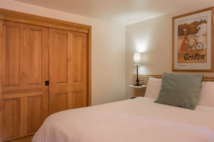 The bedroom area has pocket doors separating the bed from the kitchen and living area.