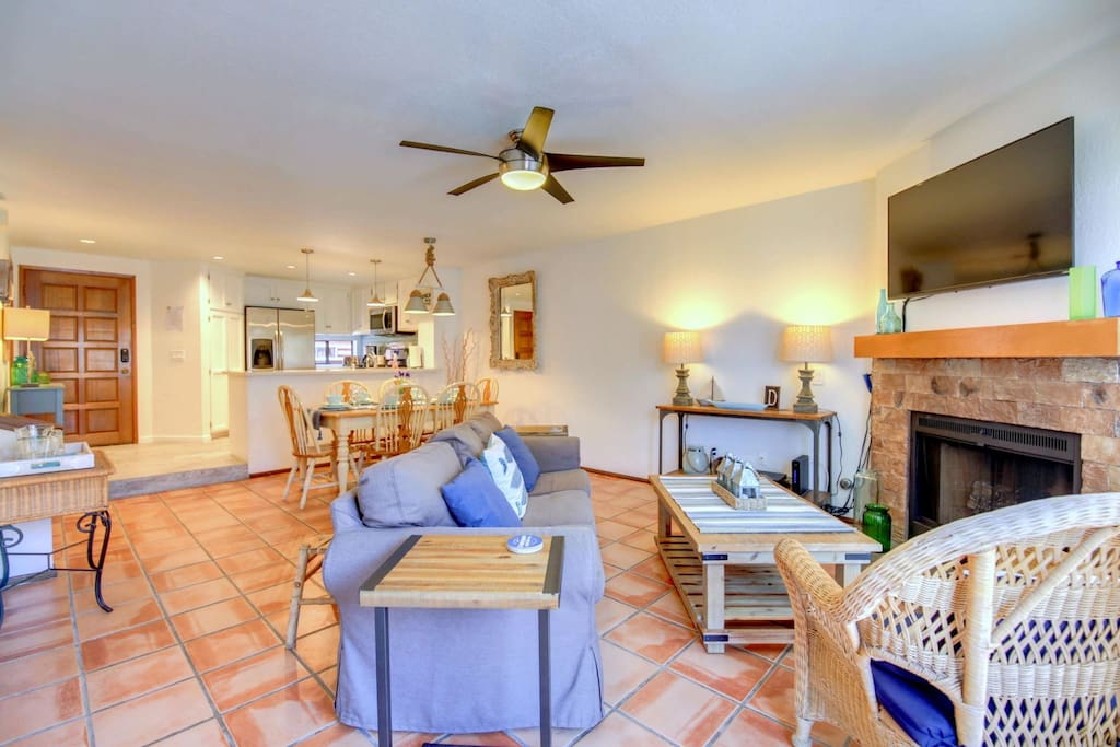 The sun-flooded, airy, open floor plan at Driftwood flows smoothly from the front entrance and kitchen into the dining and living rooms