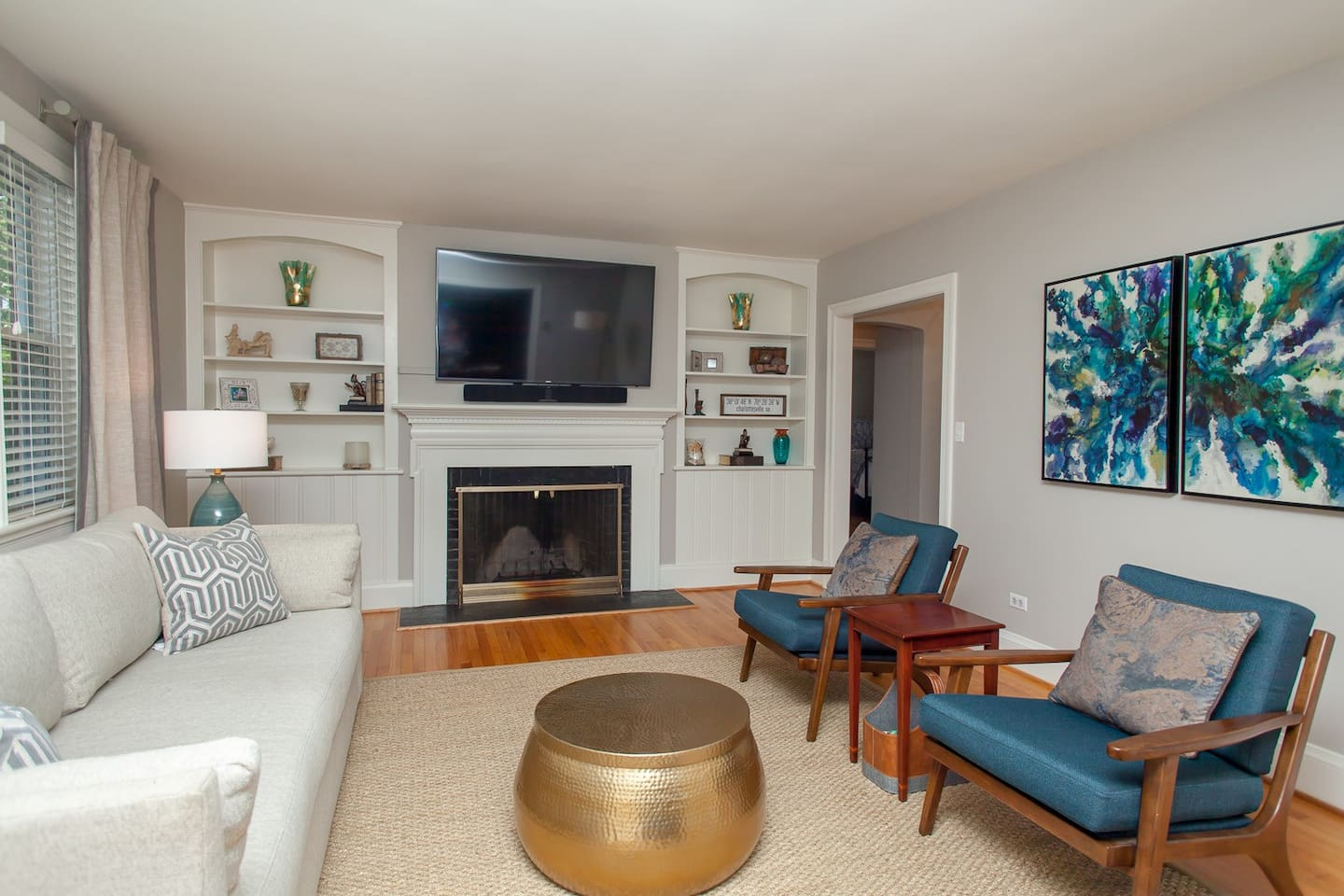 """large living room with 65"""" flat screen tv"""