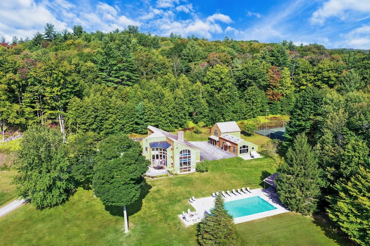 The entire estate from above. The house is located at the end of a quarter-mile long driveway, meaning you are surrounded by woods on all sides. Private trail meanders through the woods and is great for some exercise year-round!