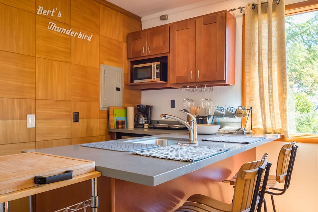 Light filled breakfast nook has all the amenities you need to make a tasty meal. Microwave, coffeemaker, toaster and a hot plate and mini-fridge are all here to help you eat well.