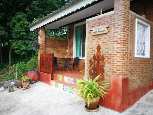 Deluxe room can accommodate up to 3 adults. It has a small balcony that allows guests to enjoy the view of doi Luang Chiang Dao.