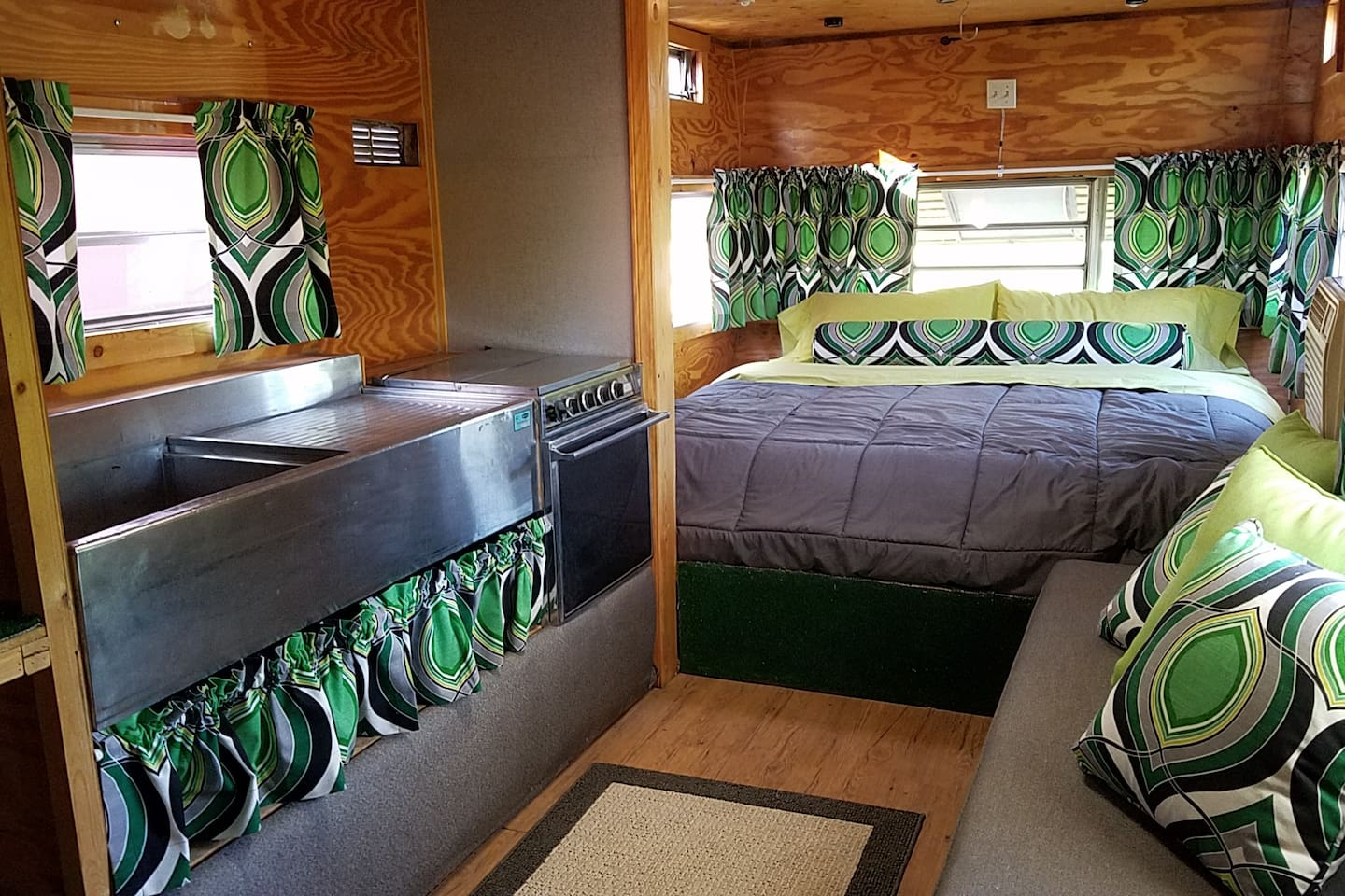 King Size bed, window A/C unit and space heater, run off a long extension cord, so you are almost off-grid, but not quite