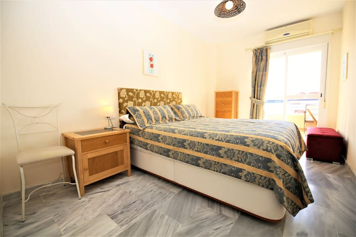 Master bedroom with double bed and access to the balcony