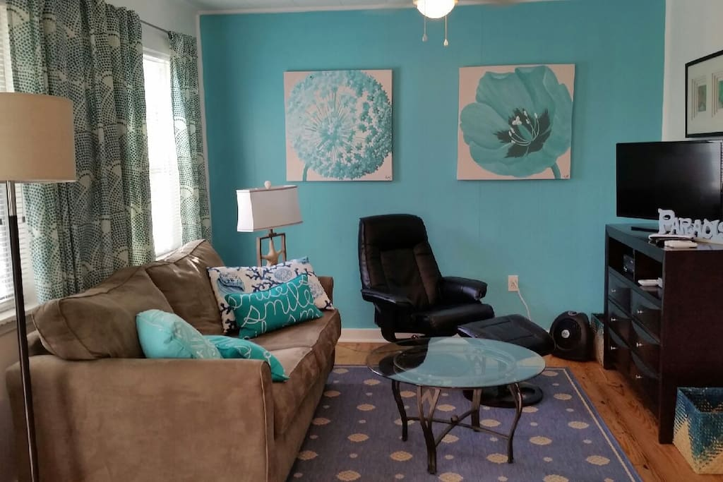 Relax in inviting family room created by our talented interior designer with new sofa sleeper, comfy recliner. New LED flat screen TV- ALL  premium movie channels included FREE! Free WIFI