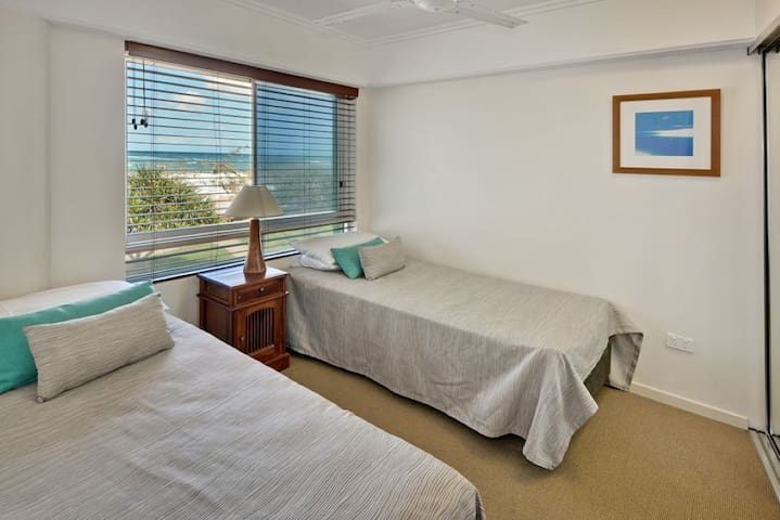 Bedroom two with beach views