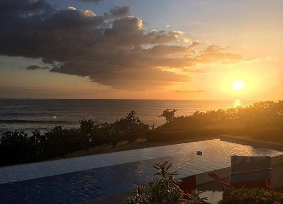 sun setting over the pool and the pacific