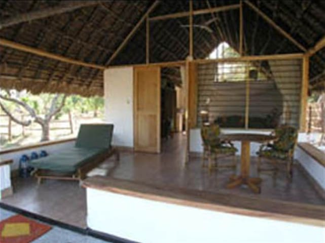 Individual cottages with verandah, where breakfast is delivered!