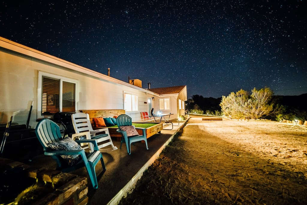 Front porch at night, grass bed, seating area, and picnic table overlook the entire valley.