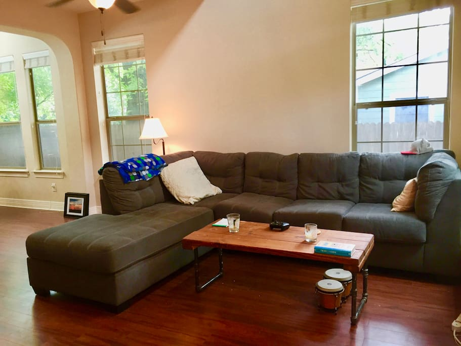 Living Room (Couch faces the Flatscreen TV and Fireplace). Locally handmade industrial coffee table