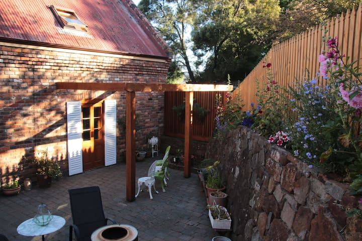 Your colourful outdoor area accessed through the cedar French doors.