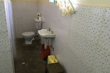 Private bathroom includes toilet, sink and tub / shower.