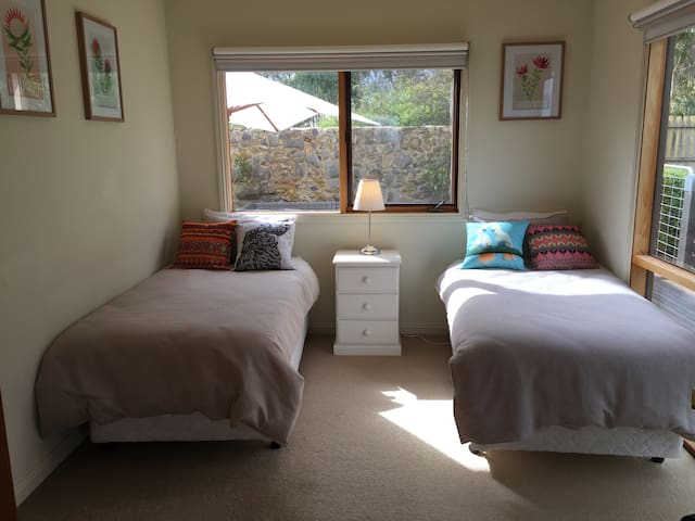 Super comfy King Single beds in front room with storage closet,electric heater and great views.