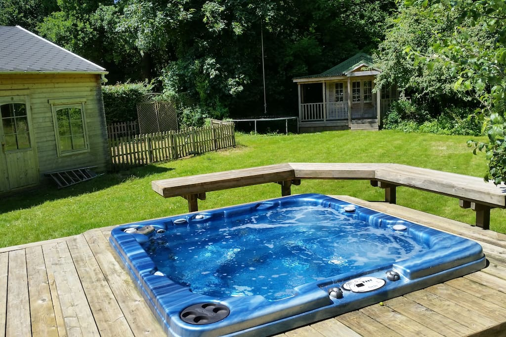 The Sunken Hot Tub with the Barn and Lodge in the background. No-one can see you in this secluded Secret Garden