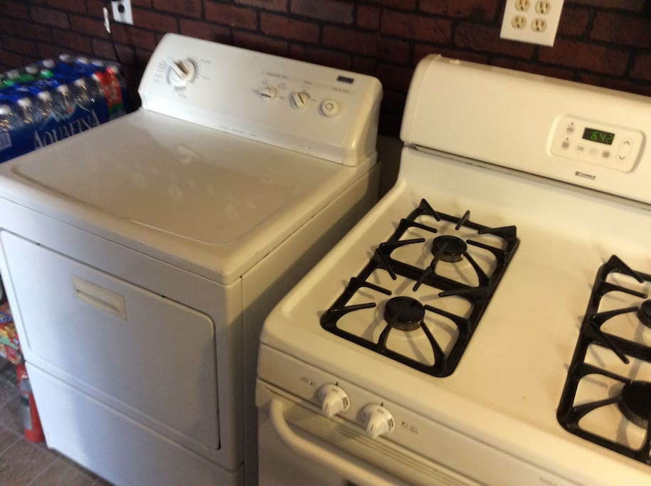 The washer and dryer are conveniently located in the kitchen area. Laundry detergent, Oxi-Clean, bleach, vinegar, baking soda, dryer sheets and fabric softener is all included!