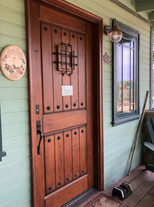 """The unique front door has a """"speakeasy"""" grille with a viewing door that opens from the inside."""